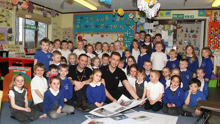 Michael Hadley (centre left) and Lewis Brown from the DPL Group with some of the children from Triml