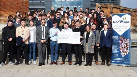 Students from the West Suffolk College hand over a chque for £4,500 to GeeWhiz