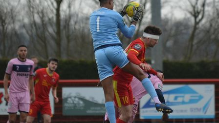 A bandaged up Jamie Griffiths pressures the Dulwich keeper. Picture: BEN POOLEY