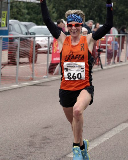 Helen Davies crossing the finish point at Colchester Half Marathon 2018. Picture: NIGE BROWN