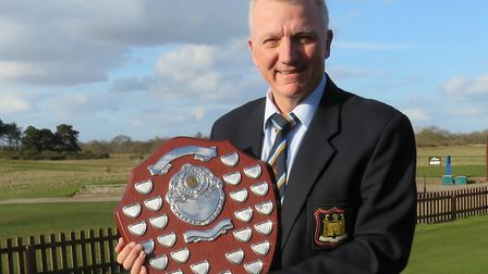 Team captain Kevin Brooks with the East Anglian Daily Times Shield which returned to Suffolk after w