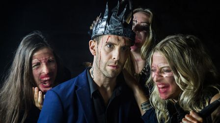 Macbeth by Mark Bruce Company which is at DanceEast. Macbeth (Jonathan Goddard) with the witches who