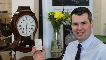 Oliver Miller, managing director of Bishop & Miller, with the signed band card. Picture: DANIEL PAGE
