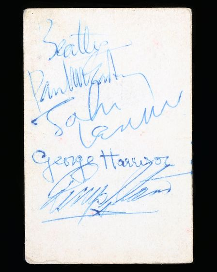 The band card, signed by all four members of The Beatles. Picture: DANIEL PAGE/BISHOP & MILLER