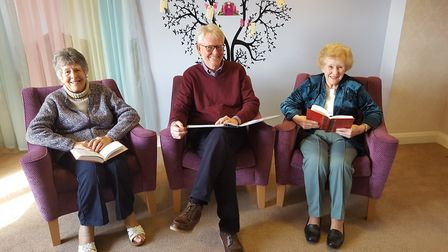 Cedrus House residents Jean Brown and Eileen Page with poet Alan Jones. Picture: Chelsea Sturman