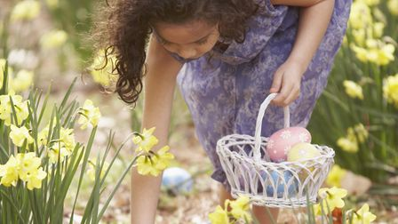 A girl collecting Easter eggs. You can choose from various Easter events this year. Picture: ARIEL S
