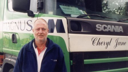 Paul Magnus, founder of the Magus Group, photographed with one of the group's lorries in 2002.