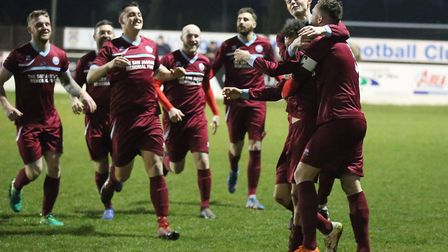 Kyle Haylock is mobbed by his Kirkley & Pakefield team-mates after putting his side ahead against Le