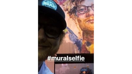 Ed snapped a selfie with his mural in central Dunedin. Picture: INSTAGRAM/TEDDYSPHOTOS
