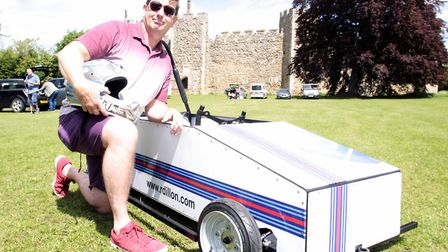 A race entrant with his go-kart and Framlingham Castle in the background. Picture: NIGEL BROWN