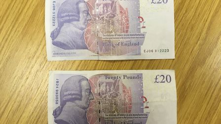 Which one is fake? One of the counterfeit notes (top) alongside a real £20 note. Picture: MICHAEL ST