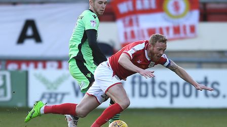 Ben Stevenson grapples for possession with Crewe's Paul Green during the U's 1-0 defeta at Gresty Ro