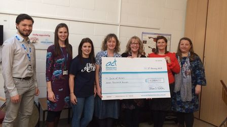 Alison Tosh (second right) hands over the cheque to Addenbrooke's Charitable Trust for £7,000. Pictu