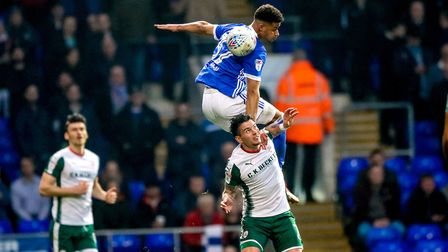 Barry Cotter rises high above Adam Hammill to win the ball in the Ipswich Town v Barnsley (Sky Bet C