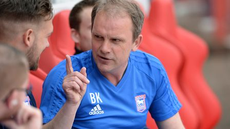Ipswich caretaker manager Bryan Klug talks to Luke Chambers on the bench at Nottingham Forest. Pictu