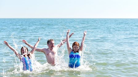 Isabelle,Chris and Ellie Hill making a splash at Aldeburgh beach. Picture: SARAH LUCY BROWN