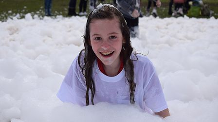 A youngster enjoying the Bubble Rush launch in Nowton Park, Bury St Edmunds. Picture: ST ELIZABETH H