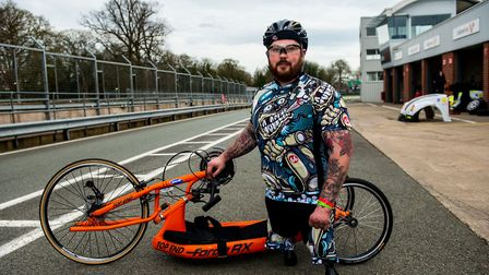 Veteran Ash Hall, 27, with one of his recumbent, hand powered bicycles. The bikes that were stolen w
