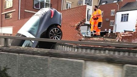 The Porsche crashed through the wall. Picture: NICOLE ROSE
