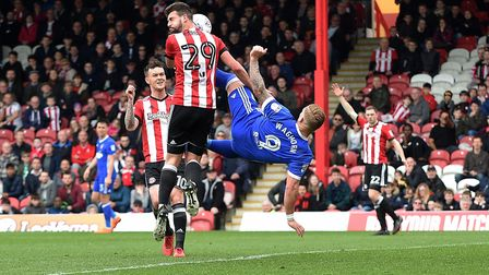 Martyn Waghorn tries an overhead kick in the Brentford penalty area Picture Pagepix
