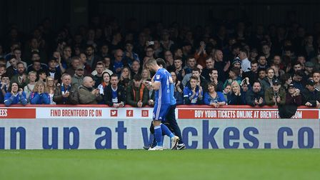An injured Luke Chambers slowly makes his way off the pitch at Brentford Picture Pagepix