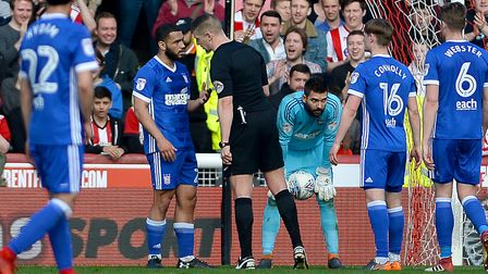 Carter-Vickers queries the referee's penalty decision at Brentford. Picture PAGEPIX
