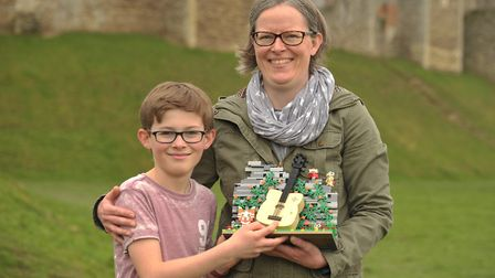 James and Vibeke Flatman with their Ed Sheeran Lego design at Framlingham Castle. Picture: SARAH