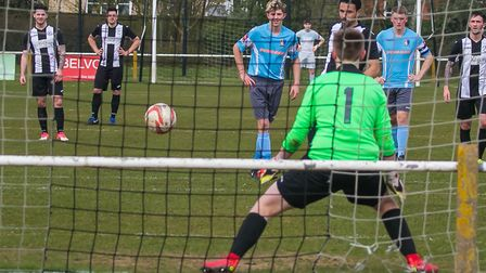 Carlos Edwards slots home a penalty as Woodbridge beat Norwich United Reserves 7-0 to clinch promoti