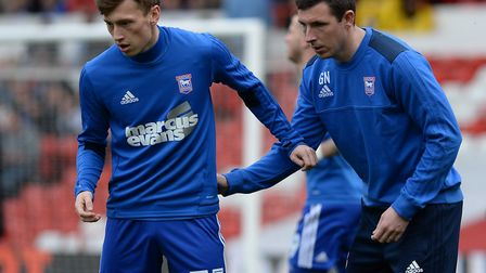 Gerard Nash warms up young Ipswich Town striker Ben Morris at Nottingham Forest last weekend. Photo: