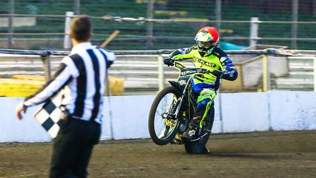 Danny King takes the chequered flag to win heat six at Foxhall against Lakeside. Picture: Steve W