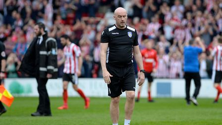 U's boss John McGreal takes a moment at the final whistle after his team had conceded a last minute