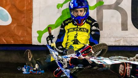 A despondent looking Nico Covatti sits on the track after crashing in heat 13. Picture: Steve Wal