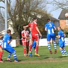 Joe Francis (7) heads home to double the score for Felixstowe. Picture: STAN BASTON