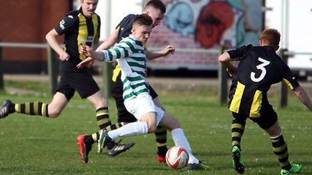 Danny Smith scores on of of his three goals in Fram's fine 5-0 win at Debenham. Picture: DEAN WARNER