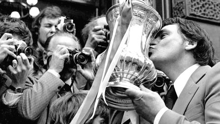 Sir Bobby Robson celebrates with the FA Cup on Cornhill, Ipswich after the 1978 triumph. Photo:
