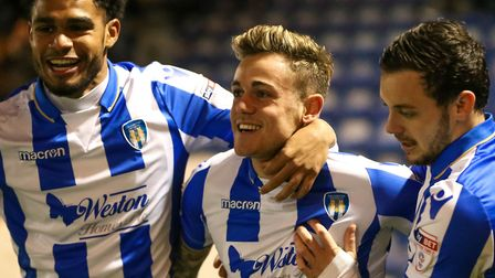 Sammie Szmodics celebrates with Mikael Mandron and Drey Wright after netting the winner for the U's