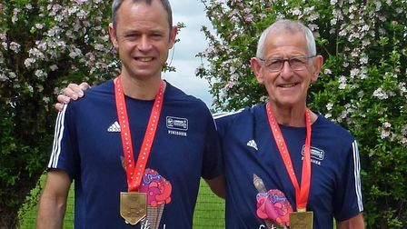 Bill Speake, left, and his father Mac Speake with their medals after completing last year's London M