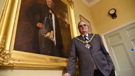 Mayor Colin Ribchester beside one of the damaged paintings. Picture: SONYA DUNCAN