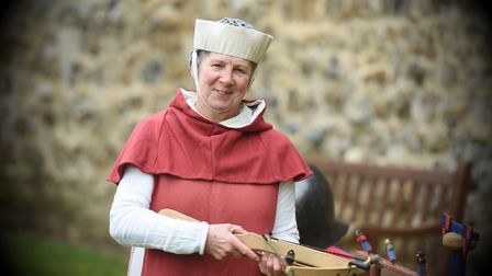 A reenactor gives a taste of history at the Medieval Life event at Framlingham Castle. Pictured is K