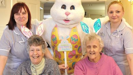 Easter Bunny with residents Jean Brown and Pamela Evans and Cedrus House team members Therese Bullbe