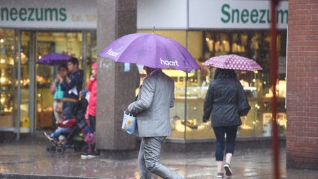 Summer washout as Suffolk is drenched in rain. Bury St Edmunds shoppers getting wet. Picture: GREGG