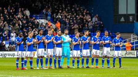 Town players take part in a minute's applause in memory of Bobby Ferguson before the game. Picture: