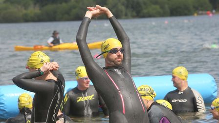 Warming up at the Great East Swim at Alton Water - the event is returning in 2018. Picture : SEANA H