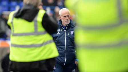 Mick McCarthy walks along the touchline at St. Andrews under the watchful eye of the cameras Picture
