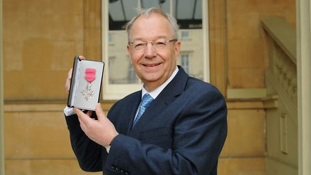 Richard Carter with his MBE at Buckingham Palace. Picture: PALACE PHOTOS