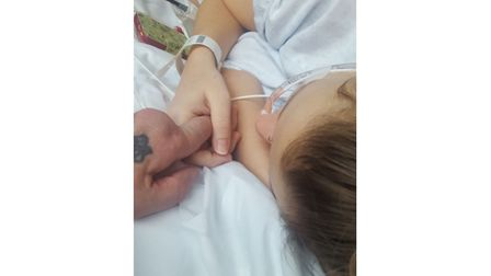 Chris holding hands with Demi at the hospital