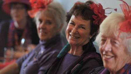 Ladies enjoyed the first birthday of the Woodbridge group of the Red Hat Society at the Coach and Ho