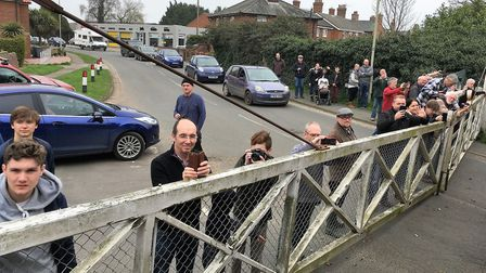 Crowds at Leiston watch the special train pass over the town's level crossing. Picture: PAUL GEATER