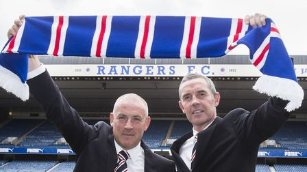 Warburton (left) and assistant David Weir. took Rangers back to the Scottish top flight. Picture: PA