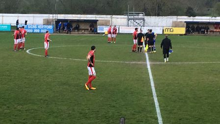 Heybridge Swifts, red shirts, ready for kick-off at Hertford during tonight's Bostik North victory a